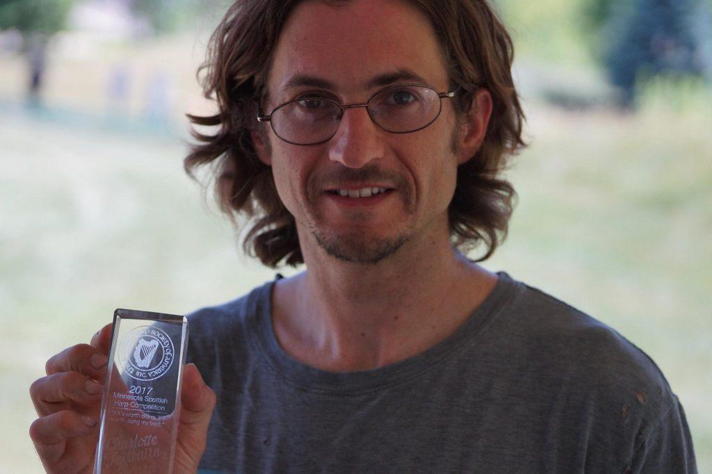 Jacob posing with the new Charlotte Fairbairn Award.